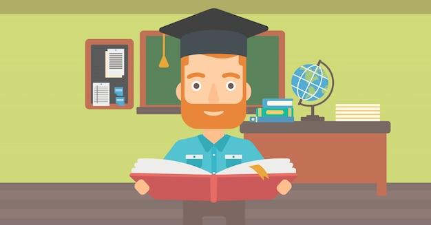 Homem de chapéu de formatura, segurando o livro. Vetor Premium