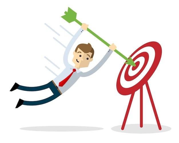 Homem de negócios com uma flecha e alvo | Vetor Premium