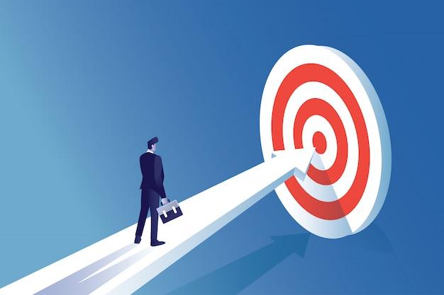 Homem de negócios de ilustração de conceito de homem em frente ao alvo para se concentrar em atingir o objetivo Vetor Premium