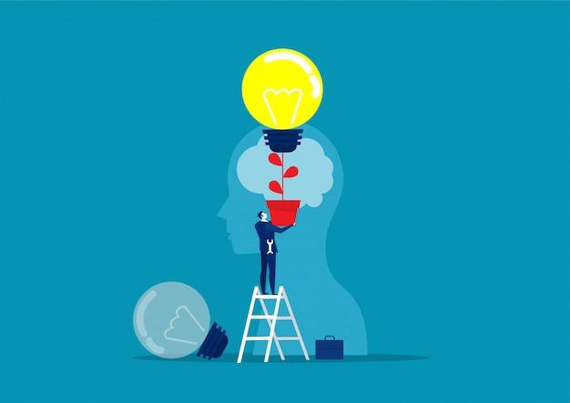 Homem de negócios de terno segurando uma lâmpada na cabeça superior humana chang idéia conceito vector Vetor Premium