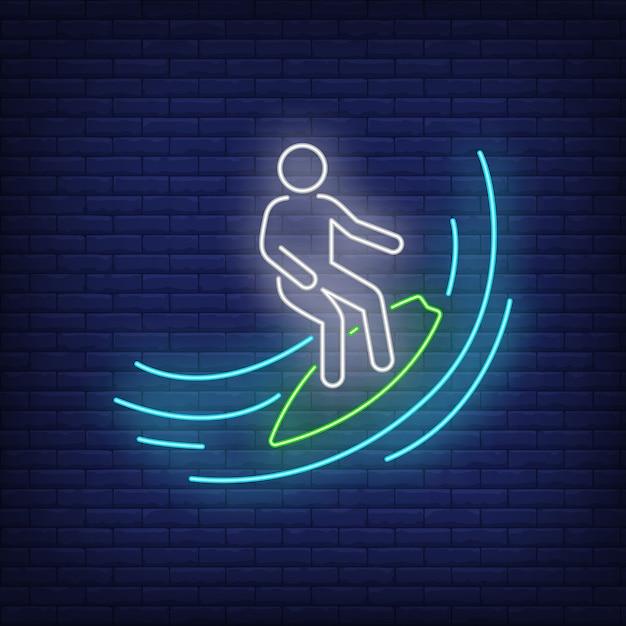 Homem de pau surfando no sinal de néon de onda Vetor grátis