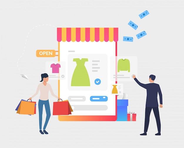 Homem e mulher comprando roupas on-line Vetor grátis