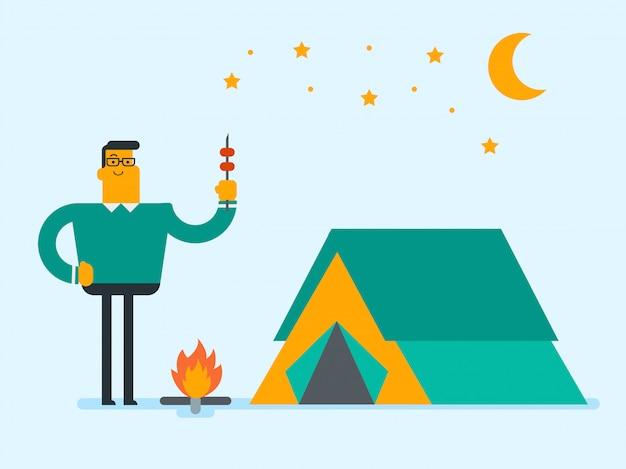 Homem que senta-se no log perto da fogueira no acampamento. Vetor Premium