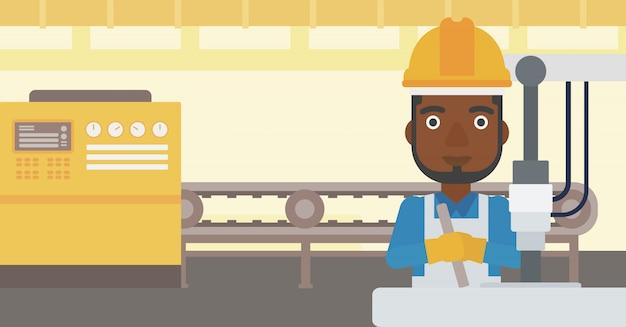 Homem que trabalha na máquina de perfuração industrial. Vetor Premium