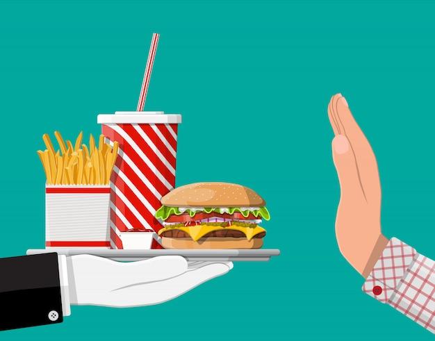 Homem se recusa a tomar fast-food com gesto com a mão Vetor Premium