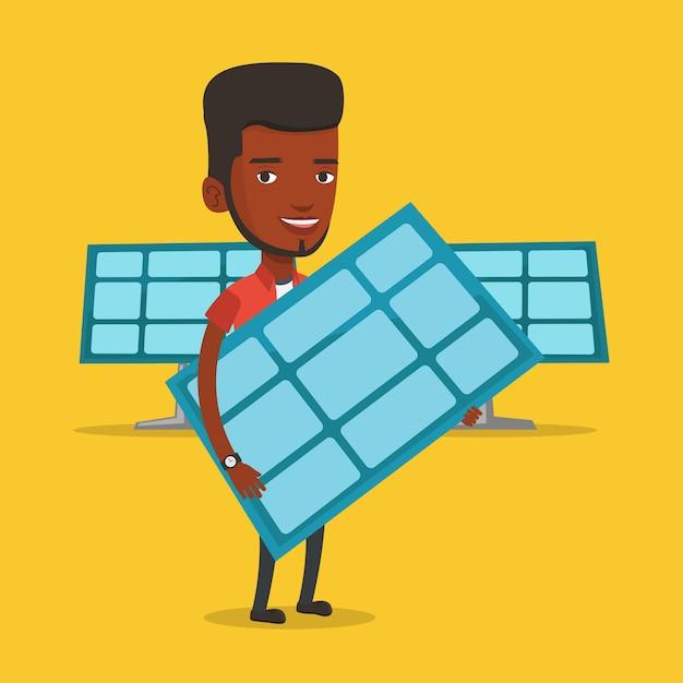 Homem segurando o painel solar. Vetor Premium