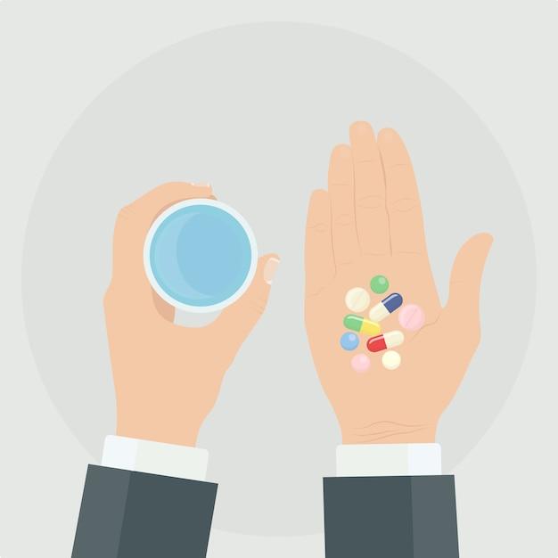 Homem tem comprimidos, comprimidos, cápsulas e um copo de água nas mãos. tomar remédios Vetor Premium