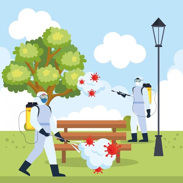 Homens com traje de proteção pulverizando árvore do parque e banco com Vetor Premium