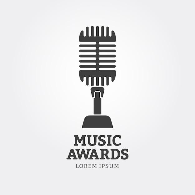 Ícone de microfone ou emblema de prêmios de música Vetor Premium
