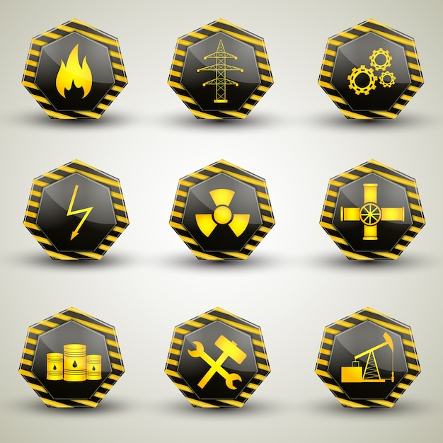 Ícones industriais pretos e amarelos com vários sinais de alerta isolados em um fundo cinza Vetor grátis