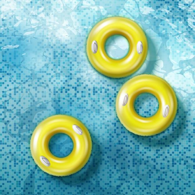 Ilustração de anéis de borracha com alças flutuando na piscina azul, vista superior Vetor Premium
