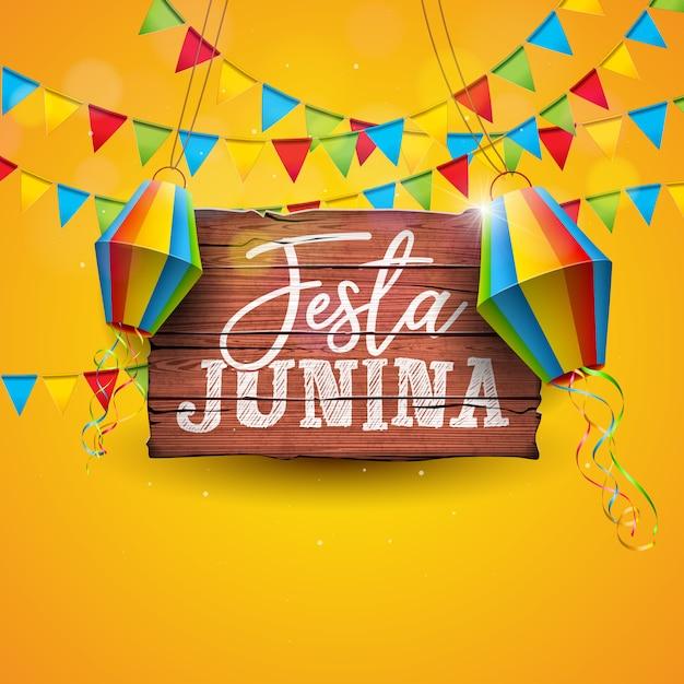 Ilustração de festa junina com bandeiras do partido e lanterna de papel no fundo amarelo. Vetor Premium