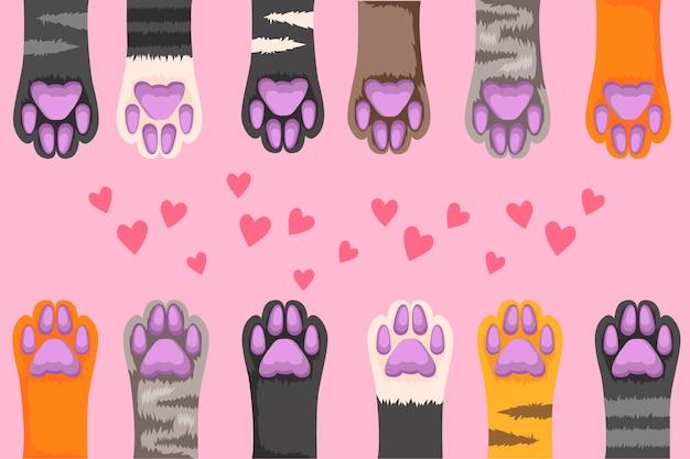 Ilustração de patas de gato multi-coloridas em um fundo rosa. Vetor Premium