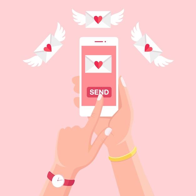 Ilustração do dia dos namorados. envie ou receba amor sms, carta, e-mail com celular branco. mão humana segure o celular, smartphone em segundo plano. envelope com coração vermelho. Vetor Premium