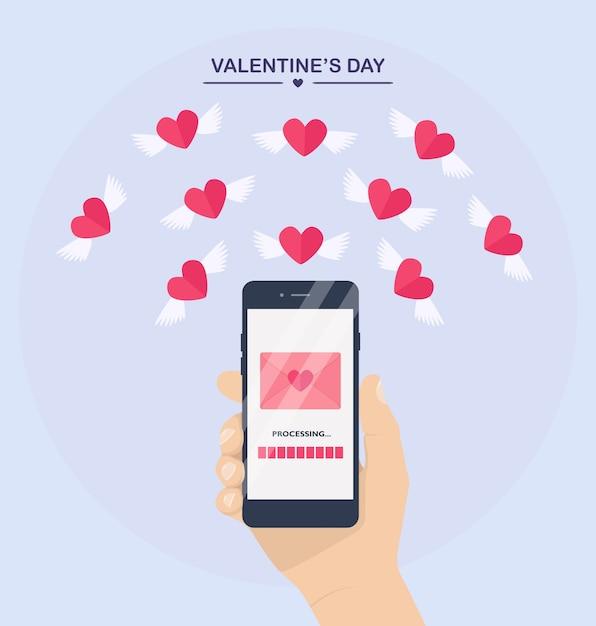 Ilustração do dia dos namorados. envie ou receba amor sms, carta, e-mail com o celular. mão humana segurar o celular no fundo. envelope, voando com um coração vermelho com asas. Vetor Premium