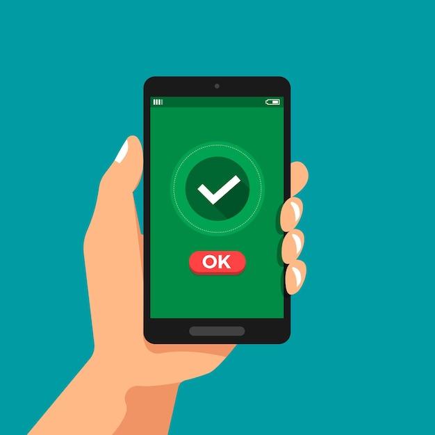 Ilustrações de conceito de design plano mão segurar confirmação de smartphone clique em ok Vetor Premium