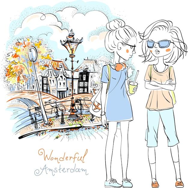 Imagem desenhada de mão, turista de lindas garotas andando pelo canal em amsterdã com a tradicional casa holandesa, holanda, holanda. Vetor Premium