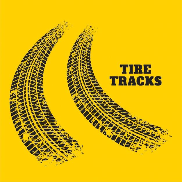 Impressões de faixa de pneu de estrada em fundo amarelo Vetor grátis