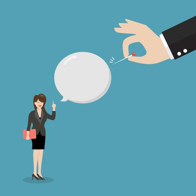 Inimigo mão empurrando a agulha para estourar seu balão de fala Vetor Premium