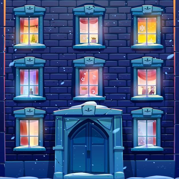 Janelas da noite da casa ou castelo com decoração de natal e ano novo Vetor grátis