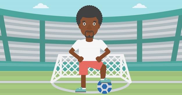 Jogador de futebol com ilustração vetorial de bola. Vetor Premium