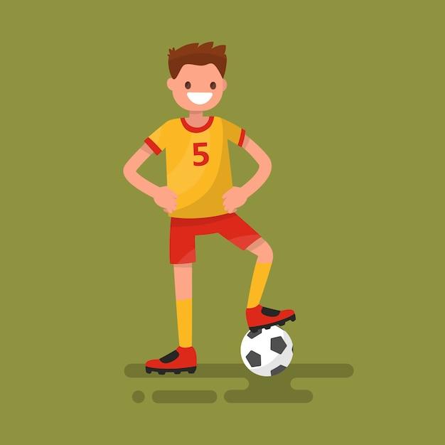 Jogador de futebol sorridente em pé com uma ilustração de bola Vetor Premium