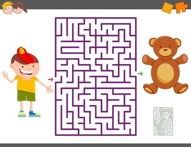 Jogo de labirinto com menino dos desenhos animados e urso de pelúcia Vetor Premium
