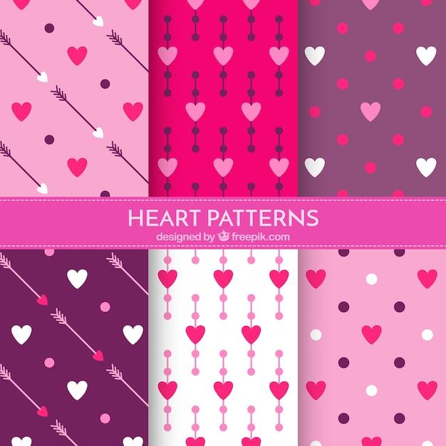 Jogo de testes padrões corações com setas e bolinhas Vetor grátis
