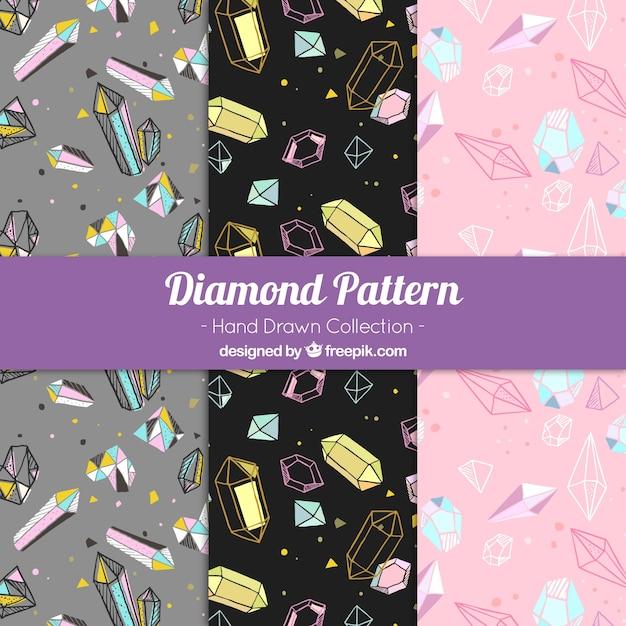 Jogo de três padrões de diamantes desenhados à mão Vetor grátis