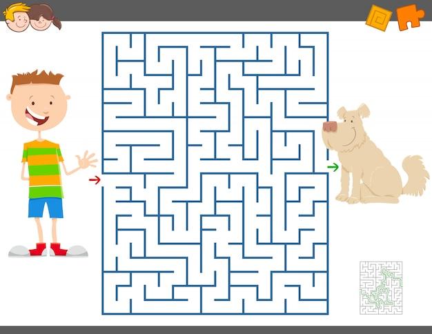 Jogo educativo de labirinto com menino e seu cachorro Vetor Premium
