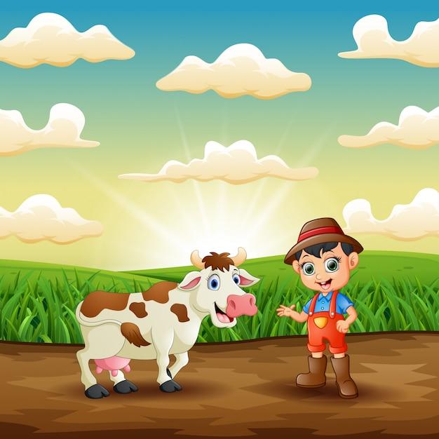 Jovem agricultor com sua vaca no campo Vetor Premium
