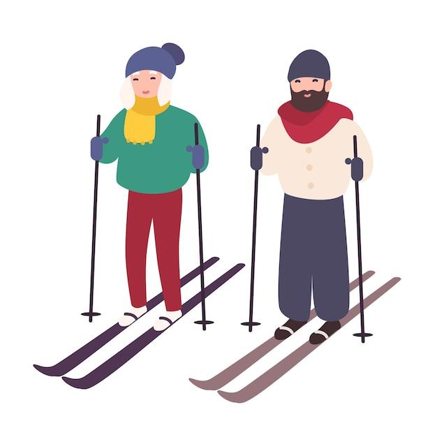 Jovem casal esquiando juntos Vetor Premium