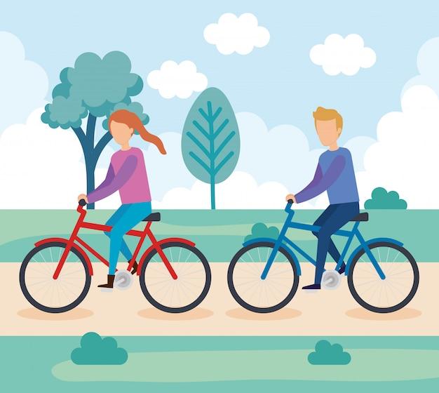 Jovem casal no personagem de bicicleta Vetor grátis