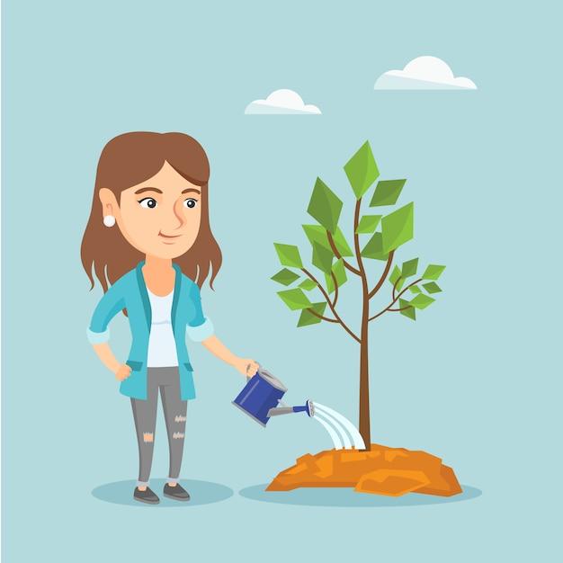 Jovem mulher caucasiana regar uma árvore. Vetor Premium