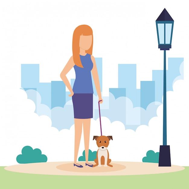 Jovem mulher com cachorro no parque Vetor grátis