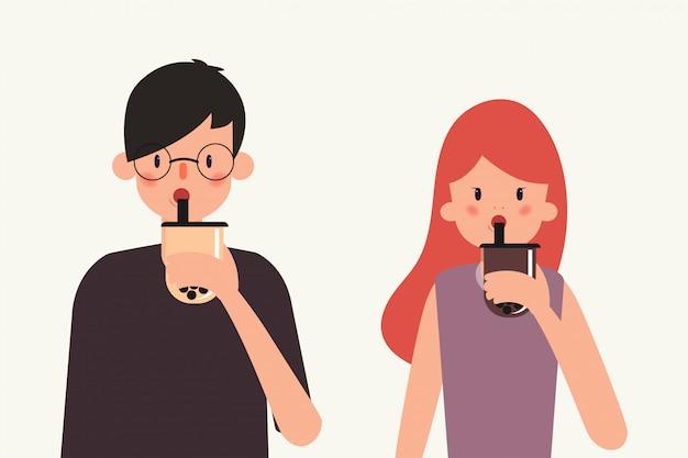 Jovens bebem chá de leite bolha. Vetor Premium
