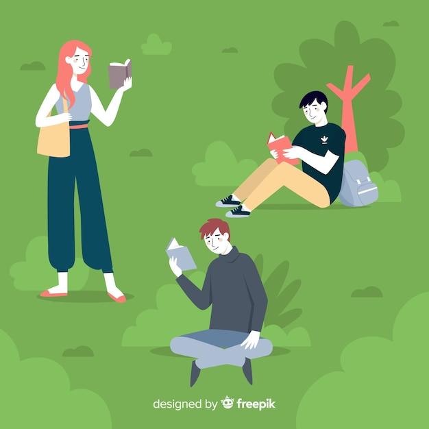 Jovens lendo na natureza Vetor grátis