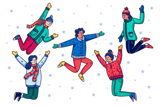 Jovens vestindo roupas de inverno pulando Vetor grátis
