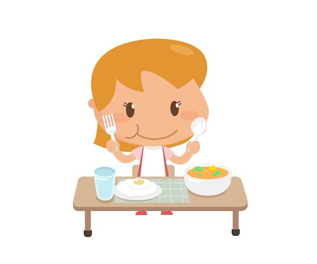 Kid está comendo alimentos sozinha Vetor Premium
