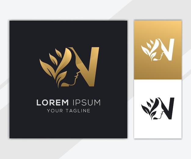 Letra n com modelo de logotipo de beleza feminina natural de luxo Vetor Premium