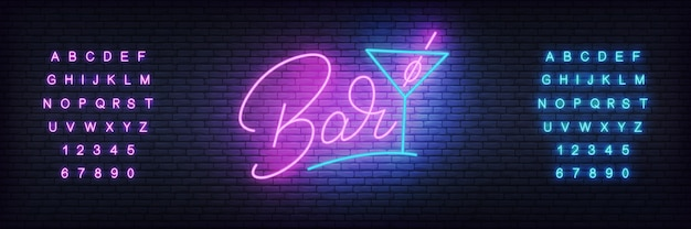 Letras brilhantes bar e copo de cocktail Vetor Premium