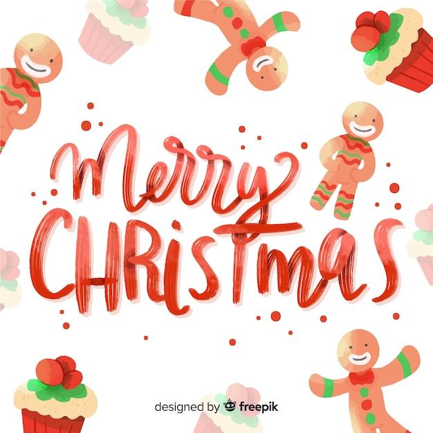 Letras coloridas de feliz natal com pão de mel Vetor grátis