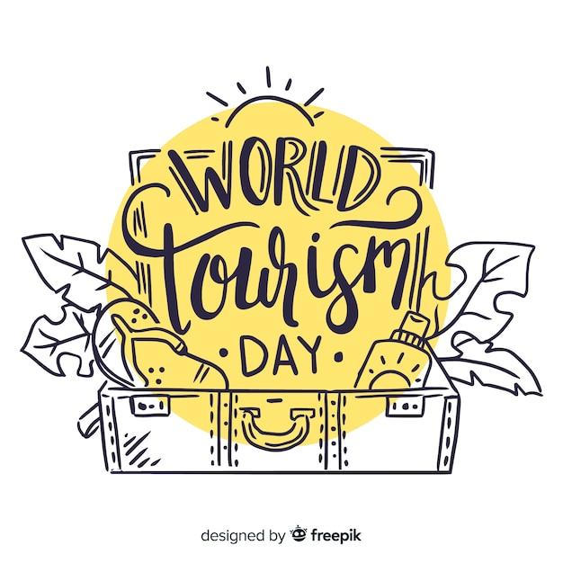 Letras de dia do turismo mundial Vetor grátis