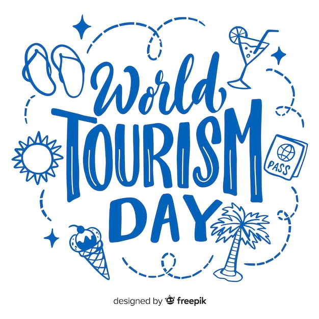 Letras de dia mundial do turismo com itens de viagem Vetor grátis