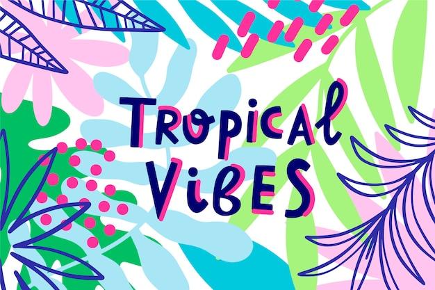 Letras de estilo tropical com folhas Vetor grátis