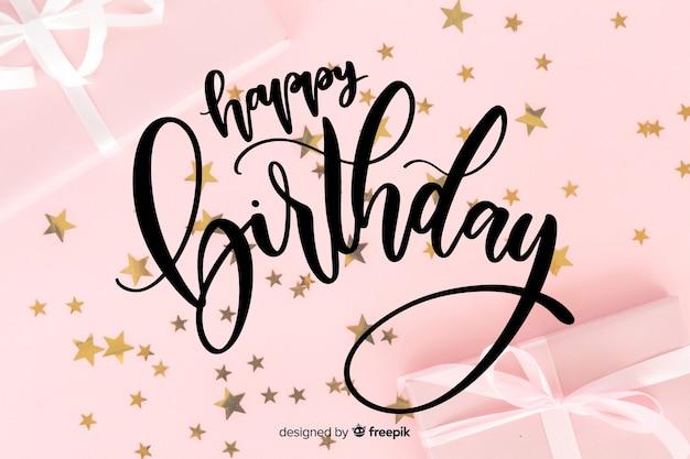 Letras de feliz aniversário com estrelas Vetor grátis