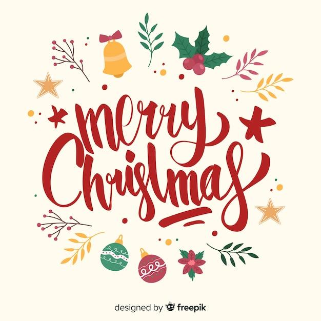 Letras de feliz natal com decoração de véspera Vetor grátis