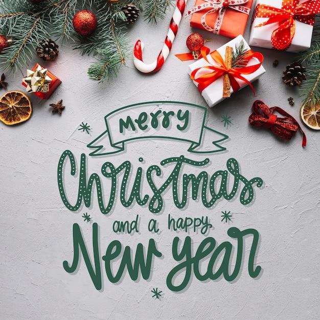 Letras de feliz natal na foto de natal Vetor grátis