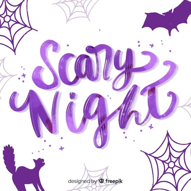 Letras de noite assustador roxo com ornamentos Vetor grátis
