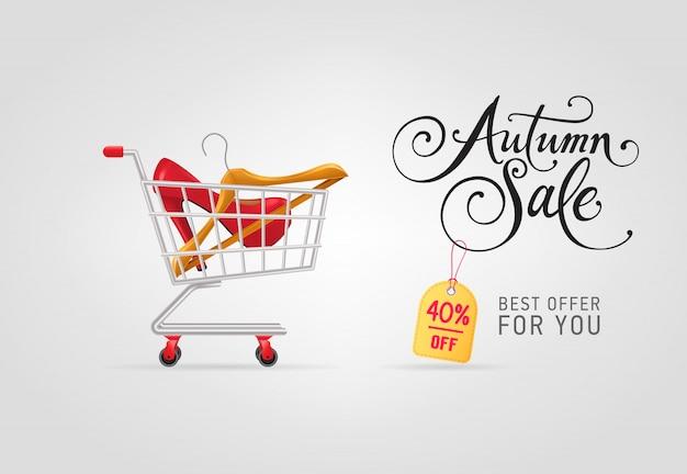 Letras de venda outono com cabide e sapato no carrinho de compras Vetor grátis